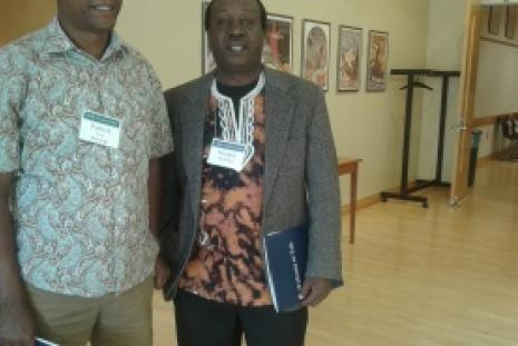 Prof. Iribe Mwangi, Chairman of the Department of Kiswahili and Prof. Mungai Mutonya from Washington University pose for a photo at a Kiswahili Conference held in Yale University.